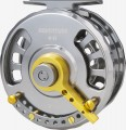 "ADVENTURE RYOBI Modern fly reel, cut out from one piece of ultralight aluminium in CNC technology. Equipped with additional lever: so called "" fight brake "".  The higher quality layer of the whole reel's surface what protects against corrosion. Precise multi -  disc brake and thrust bearing. width="